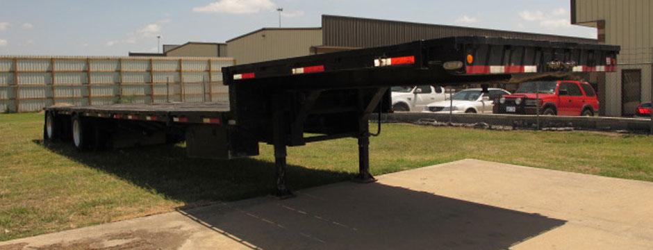 https://innovaindustries.com/wp-content/uploads/2012/03/drop-deck-trailer-for-sale-slider.jpg